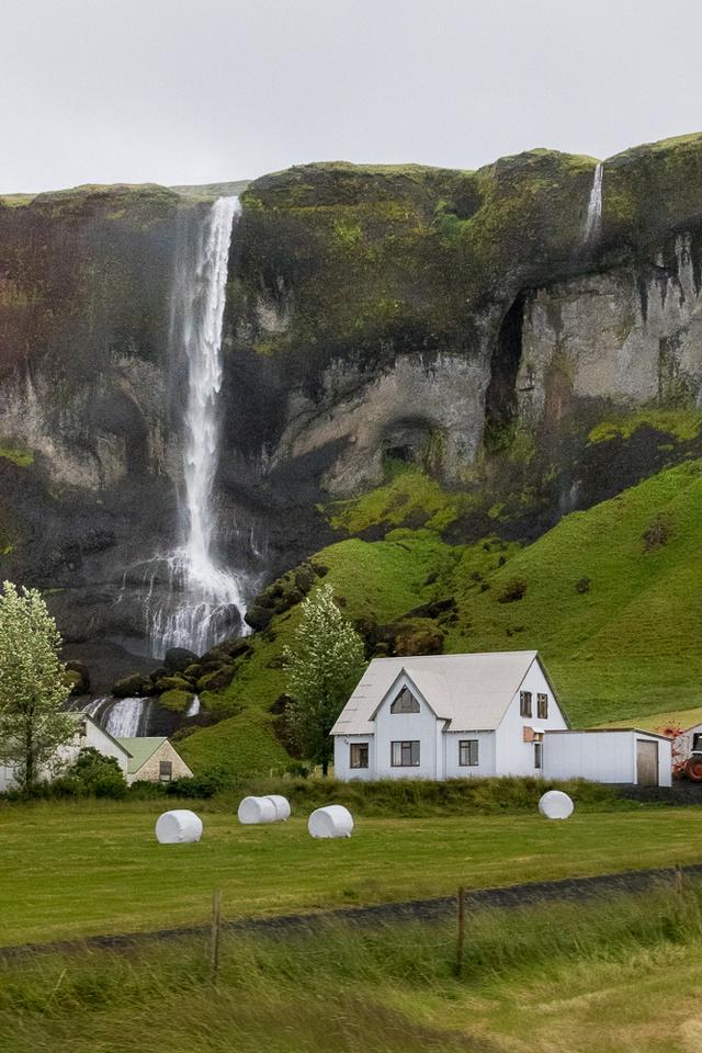 White farm house by Foss a Sidu Waterfall