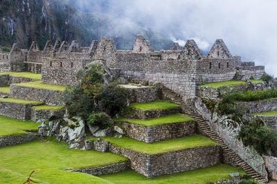 Fog advancing on Machu Picchu, Peru