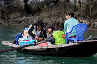 Family coming from market on Ha Long Bay