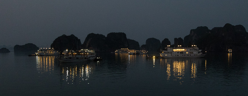 Cruise Ships anchored for the night, Ha Long Bay, Vietnam