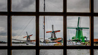 Three windmills in window panes