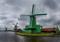 Three Zaanse Schans windmills on the banks of the Zaan river
