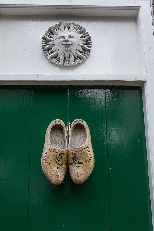 Wooden Shoes on green door