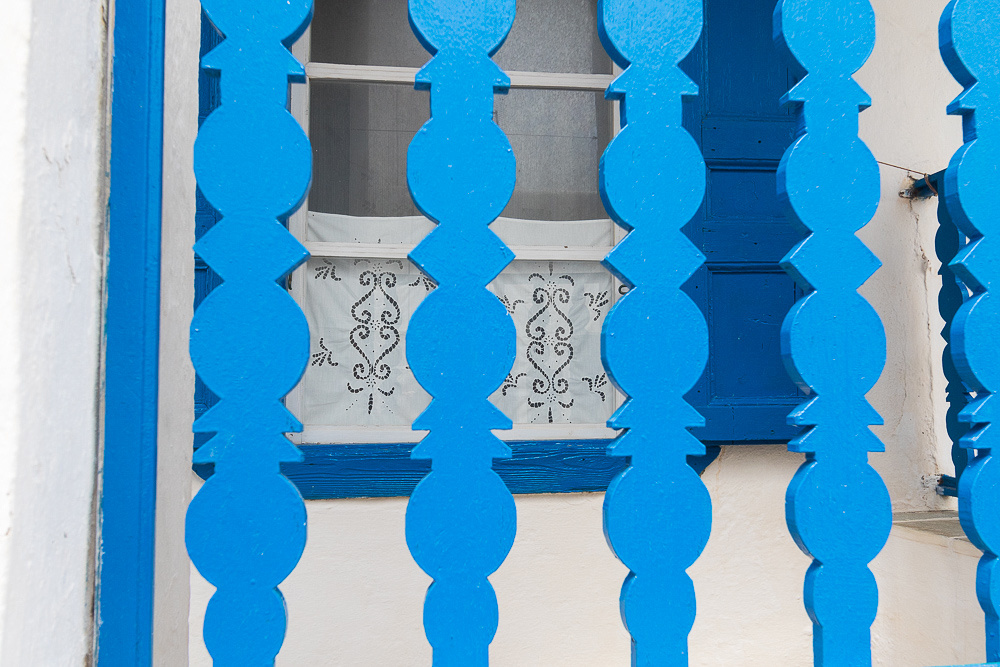 Blue balustrade & Lace curtain