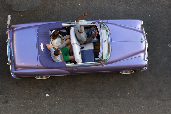 Taking a ride in a 1950's purple Chevy