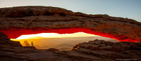 Yellow Sunrise behind Mesa Arch
