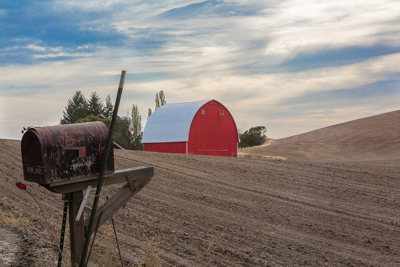 Mailbox and red barn