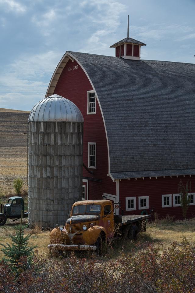 Red barn and yellow truck