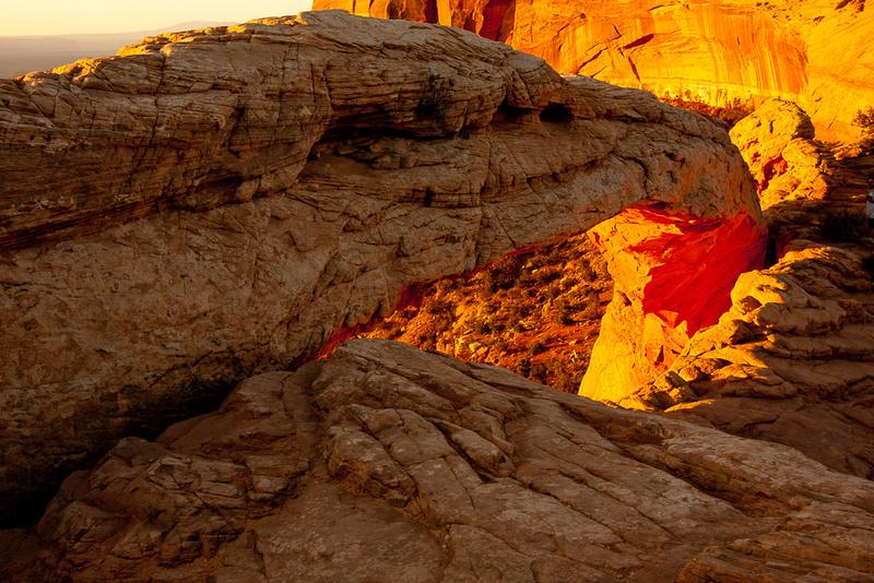 Yellow Sunrise behind Mesa Arch